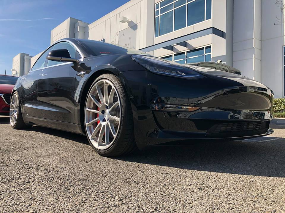 Black Tesla Model 3 lowered with big brakes and 20 ...