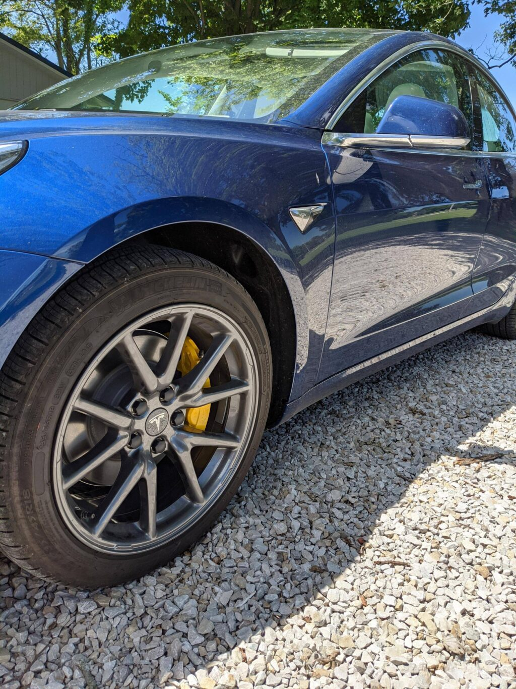 Model 3 with Aero wheels with yellow painted calipers ...
